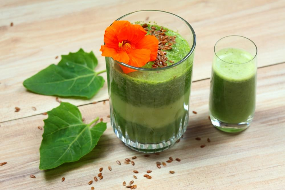 Green smoothie is complimented with the bold, orange nasturtium