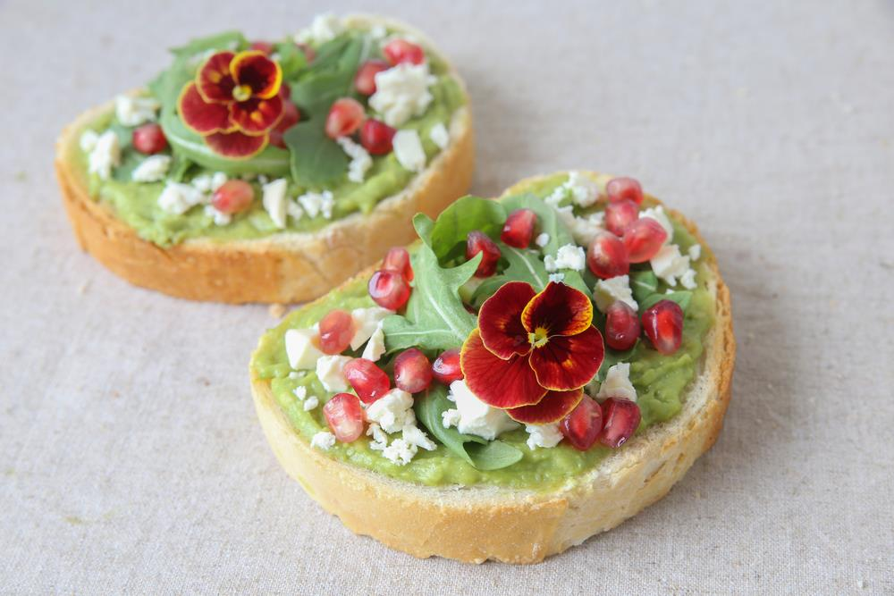 Pomegranate and cheese toast with a pansy topper