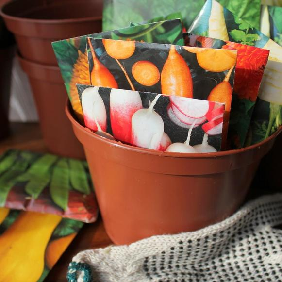 Seed packets in a pot